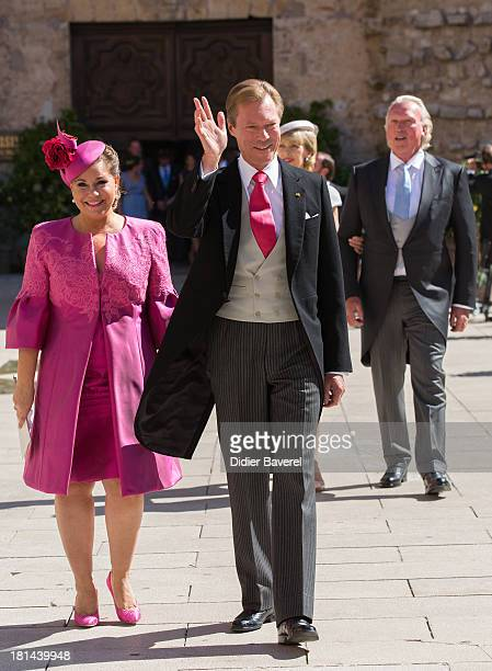 Grand Duchess Maria Teresa of Luxembourg and Grand Duke Henri of Luxembourg leave the the religious wedding of Prince Felix of Luxembourg and Claire...