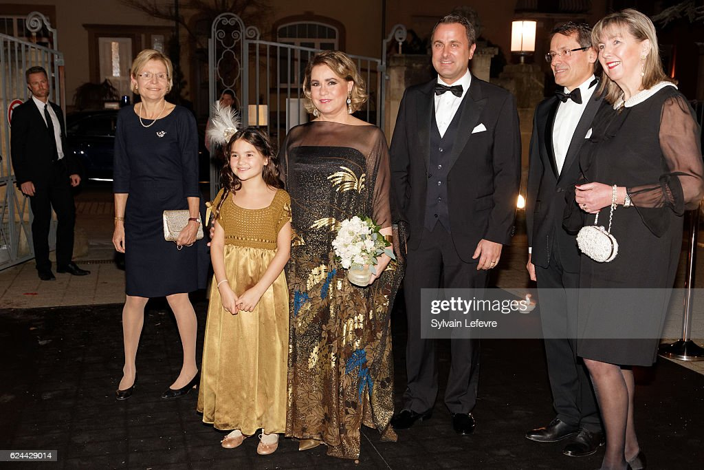 Grand Duchess Maria Teresa of Luxembourg (C) and Luxembourg Prime Minister Xavier Bettel (3rd L) arrive for the 20th Luxembourg Red Cross Ball Gala on November 19, 2016 in Luxembourg, Luxembourg.