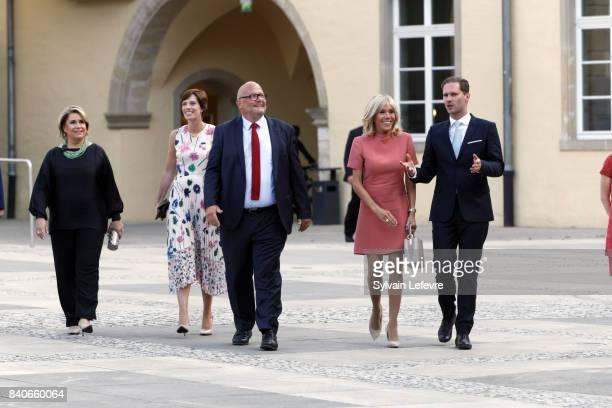 Grand Duchess Maria Teresa of Luxembourg Belgian Prime Minister's partner Amelie Derbaudrenghien guest Brigitte MacronTrogneux France's first lady...