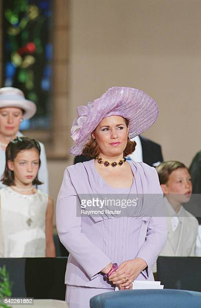 Grand Duchess Maria Teresa with her children Alexandra and Sebastien behind her