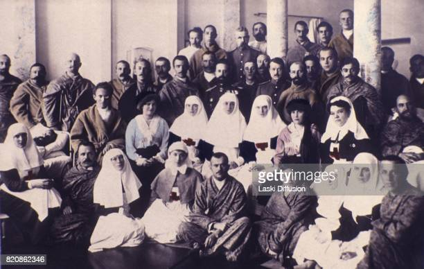Grand Duchesses Maria and Anastasia daughters of Tsar Nicholas II Romanov visit a hospital during World War I Picture coloured by one of Tsar's...
