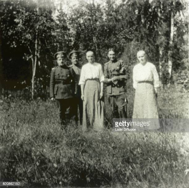 Grand Duchesses of Russia with shaved heads after contracting measles Next to them are Russian army officers Tsarskoye Selo Russia March 1917 after...