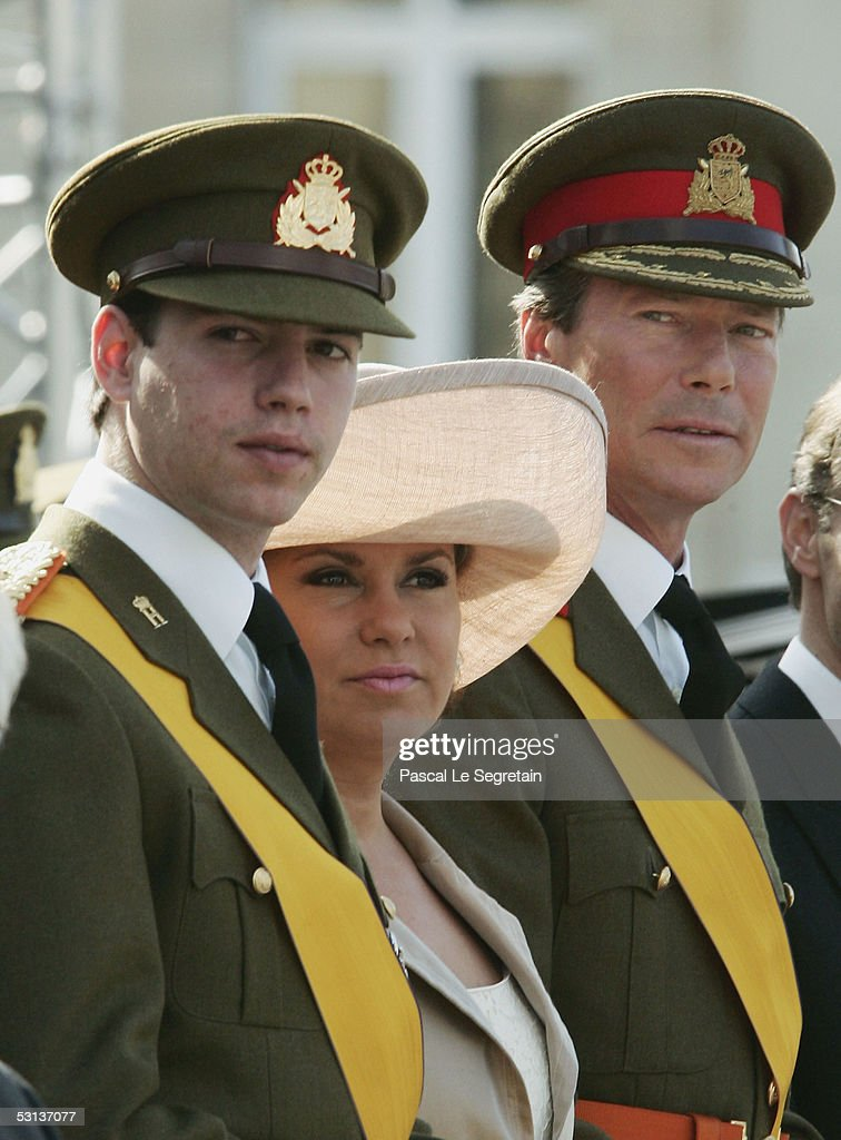Grand Duke Guillaume of Luxembourg, Grand Duchess Maria Teresa, the Duchess of Luxembourg and Grand Duke Henri, the Grand Duke of Luxembourg, attend a military parade as part of National day celebrations on June 23, 2005 in Luxembourg.