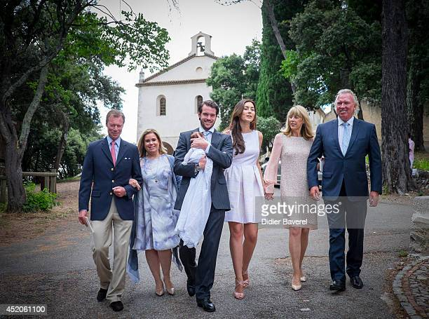 Grand Duke Henri and Grand Duchess Maria-Teresa of Luxembourg, pose with their son Prince Felix holding his daughter Princess Amalia, and his wife...