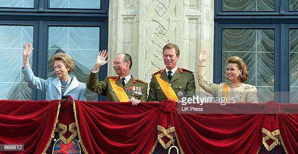 Grand Duke Henri and his wife Grand Duchess Maria Teresa greet the population from the balcony of the Grand Ducal Palace with Henri's parents their...