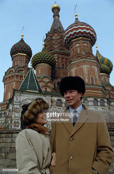 Grand Duke Henri de Luxembourg and his wife Duchess Maria Teresa stand in front of Saint Basil Church at Red Square during their private visit to...