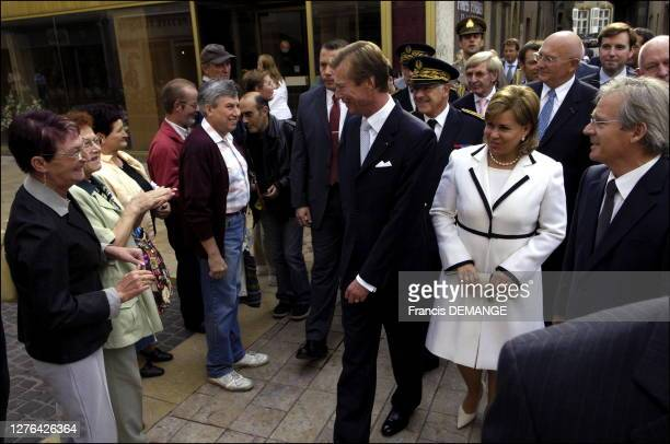 Grand Duke Henri, Grand Duchess Maria-Teresa and Thionville deputy and mayor Jean-Marie Demange walk about the city.