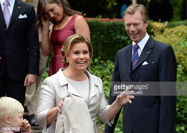 Grand Duke Henri of Luxembourg and Grand Duchess Maria Teresa of Luxembourg gesture at the family photo after the Civil Wedding Ceremony of their son...