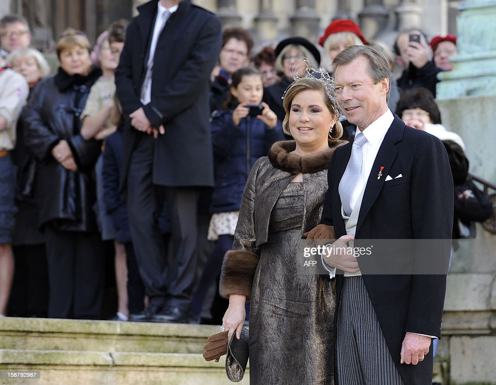 Grand Duke Henri of Luxembourg and Grand Duchess Maria Teresa of Luxembourg pose in front of the Saint Epvre Basilica before the wedding of Archduke of Austria Christoph of Habsbourg with Adelaide Drape-Frisch, on December 29, 2012 in Nancy.