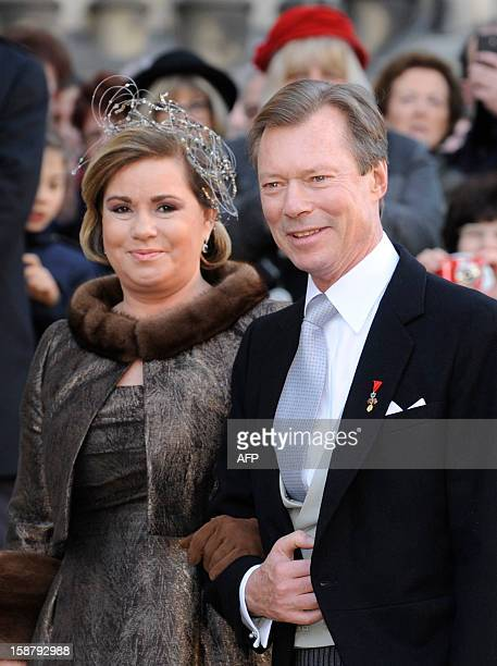 Grand Duke Henri of Luxembourg and Grand Duchess Maria Teresa of Luxembourg pose in front of the Saint Epvre Basilica before the wedding of Archduke...