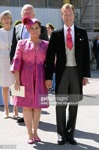 Grand Duke Henri of Luxembourg and Grand Duchess Maria Teresa of Luxembourg pose for photographers after the Wedding Ceremony of their son Prince...