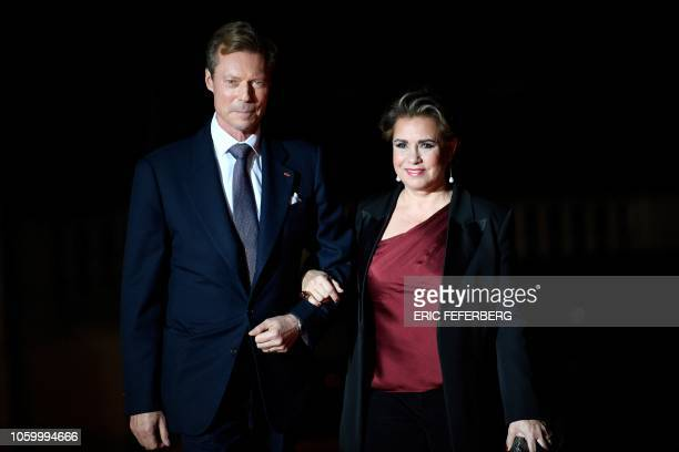 Grand Duke Henri of Luxembourg and Grand Duchess MariaTeresa of Luxembourg pose as they arrive at the Musee d'Orsay in Paris on November 10 2018 to...