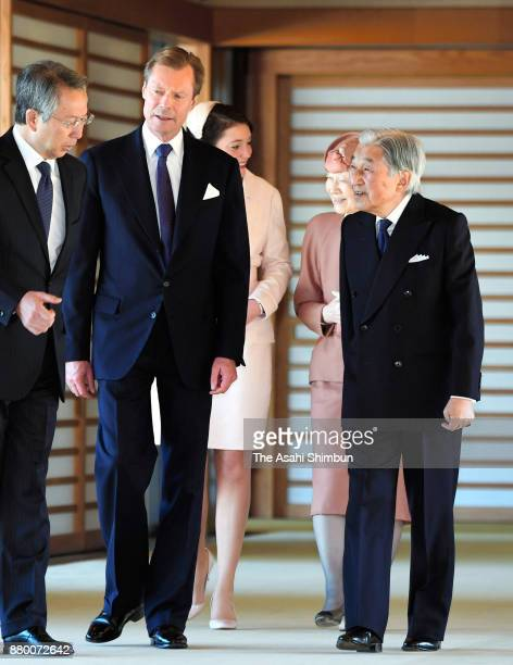 Grand Duke Henri of Luxembourg and his daughter Princess Alexandra of Luxembourg walk a corridor with Emperor Akihito and Empress Michiko prior to...