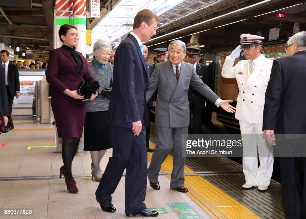 Grand Duke Henri of Luxembourg and his daughter Princess Alexandra of Luxembourg are escorted to the special train by Emperor Akihito and Empress...