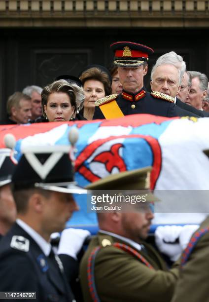 Grand Duke Henri of Luxembourg and his wife Grand Duchess Maria Teresa of Luxembourg stand behind the coffin during the funerals of Grand Duke Jean...