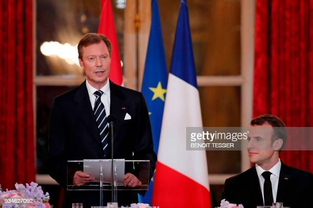 Grand Duke Henri of Luxembourg delivers a speech as French President Emmanuel Macron looks on during a state dinner for the Grand Duke and the Grand...