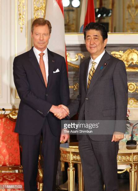 Grand Duke Henri of Luxembourg shakes hands with Japanese Prime Minister Shinzo Abe at the Akasaka State Guest House on October 25 2019 in Tokyo Japan