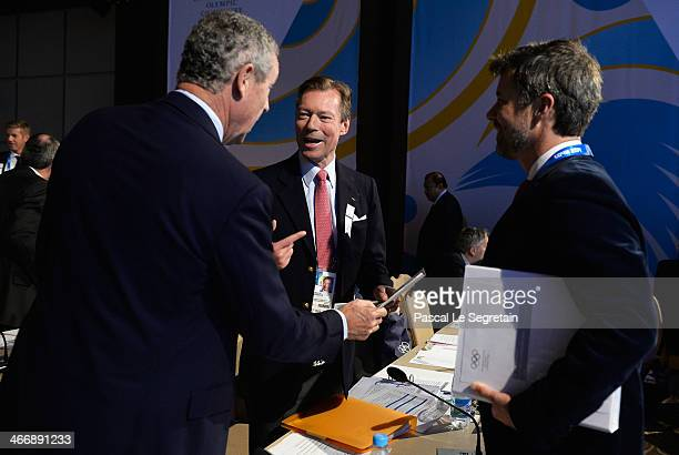 Grand Duke Henri of Luxembourg talks to Guy Drut of France and Prince Frederik of Denmark as they attend the International Olympic Committee meeting...
