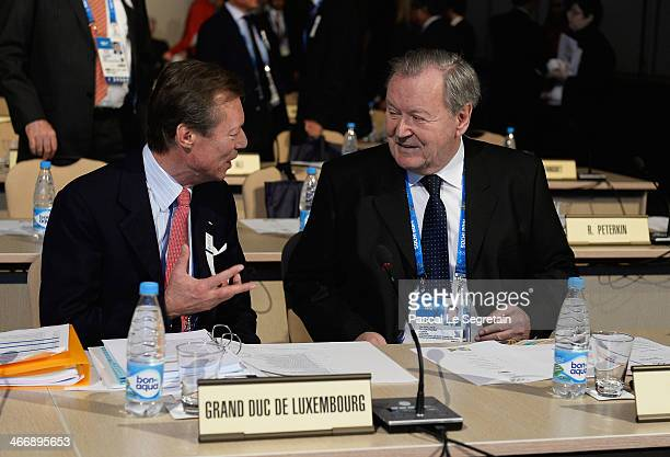 Grand Duke Henri of Luxembourg talks to Leo Wallner of Austria as they attend the International Olympic Committee meeting ahead of the Sochi 2014...