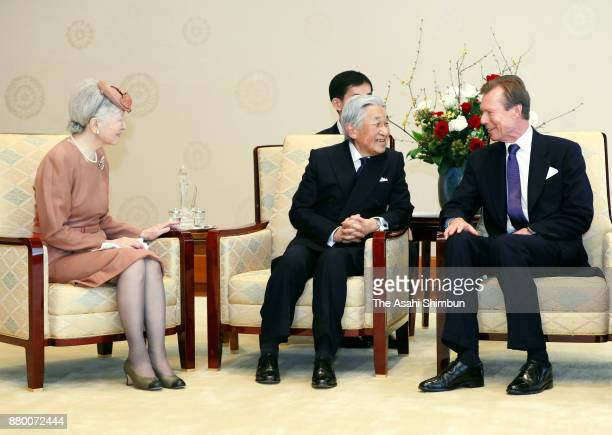 Grand Duke Henri of Luxembourg talks with Emperor Akihito and Empress Michiko during their meeting at the Imperial Palace on November 27 2017 in...