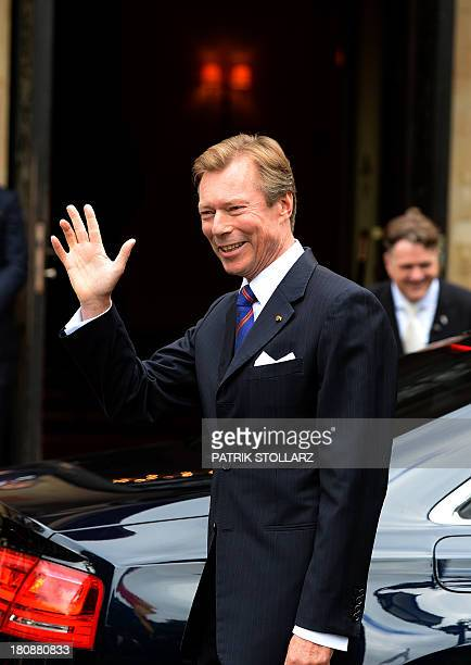 Grand Duke Henri of Luxembourg waves upon arrival at the Civil Wedding Ceremony of his son on September 17 2013 in Konigstein am Taunus western...