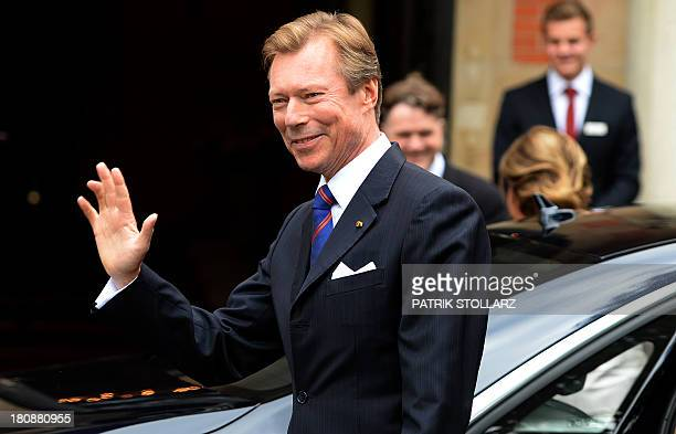 Grand Duke Henri of Luxembourg waves upon arrival at the Civil Wedding Ceremony of his son on September 17, 2013 in Konigstein am Taunus, western...