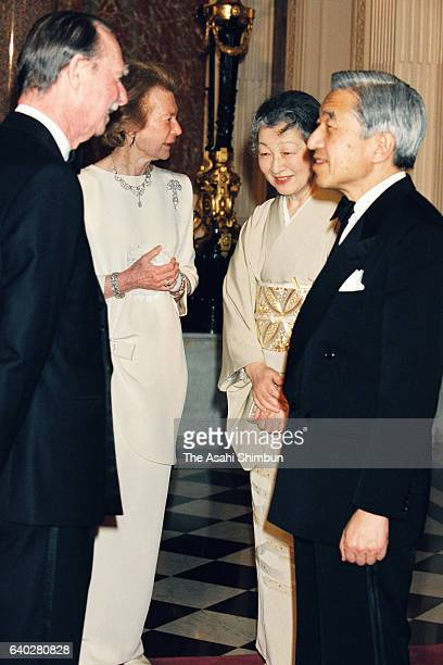 Grand Duke Jean and Grand Duchess Josephine Charlotte of Luxembourg welcome Emperor Akihito and Empress Michiko prior to a return reception at the...