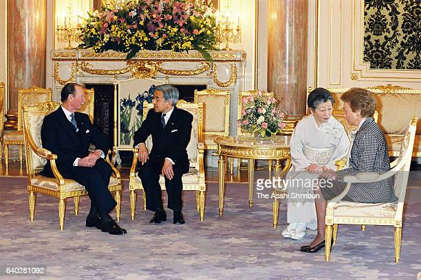 Grand Duke Jean of Luxembourg and Emperor Akihito talk while Empress Michiko and Grand Duchess Josephine Charlotte of Luxembourg talk during their...