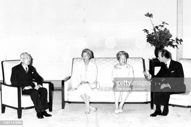 Grand Duke Jean of Luxembourg and Grand Duchess Josephine Charlotte of Luxembourg talk with Emperor Hirohito and Empress Nagako during their meeting...