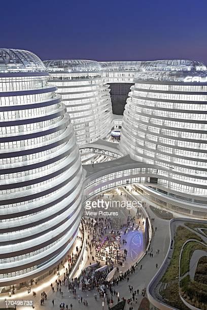 Grand elevated view into public courtyard of complex at night Galaxy Soho Beijing China Architect Zaha Hadid Architects 2012