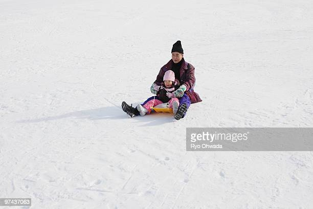 Grand father and child playing snow