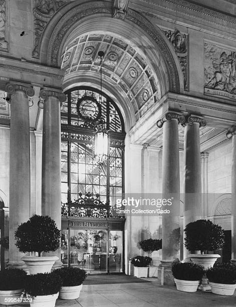 Grand front entrance of the Los Angeles Biltmore Hotel with ornate carved arch and glass doors Los Angeles California 1953