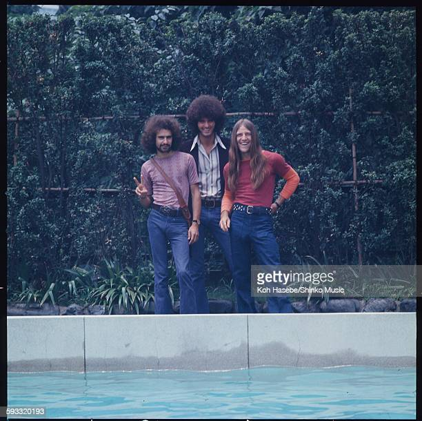 Grand Funk Railroad photo session at hotel poolside on their first visit to Japan, Tokyo, July 1971.