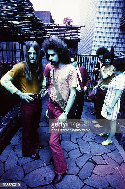 Grand Funk Railroad photo session at the entrance of the Japanese house on their first visit to Japan, Tokyo, July 1971.