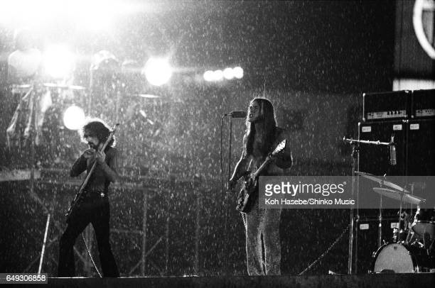 Grand Funk Railroad playing in heavy rain at Korakuen stadium, June 17th, 1971.