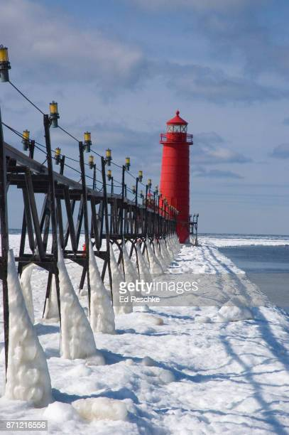 grand haven lighthouse, winter scene - ed reschke photography stock photos and pictures