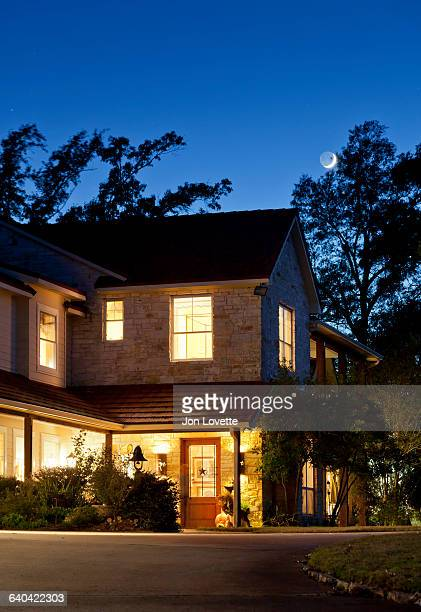 Grand Home at Twilight with moon