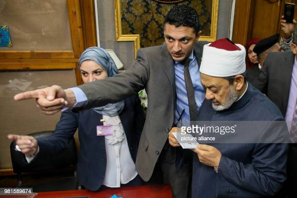 Grand Imam of alAzhar Ahmed elTayeb checks his ballot before casting his vote on the first day of the 2018 Egyptian presidential elections at a...