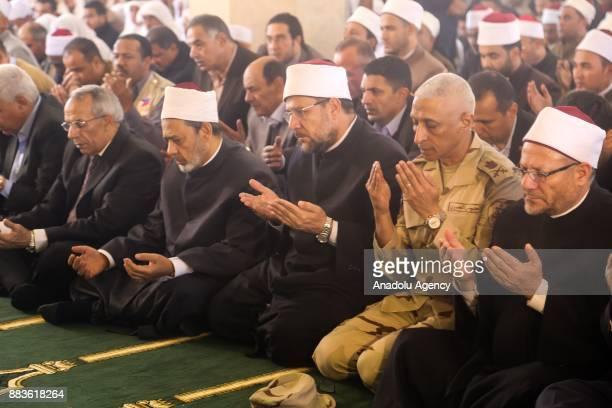 Grand Imam of alAzhar Sheikh Ahmed elTayeb Egypt's Grand Mufti Shawki Allam and North Sinai Governor General Abd elFattah Harhour perform Friday...