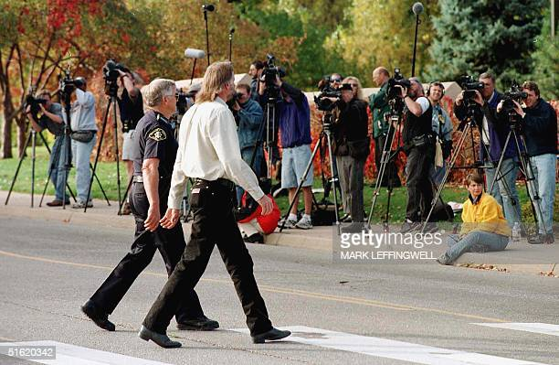 Grand jurist for the JonBennet Ramsey murder case Martin Pierce is escorted by police from the parking lot to the Boulder County Justice Center 12...