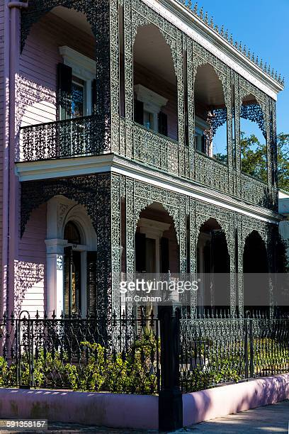 Grand mansion house ornate lacy iron balcony and double gallery in the Garden District New Orleans Louisiana USA