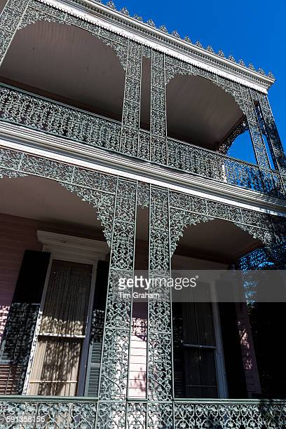 Grand mansion house ornate lacy ironwork balcony and double gallery in the Garden District New Orleans Louisiana USA