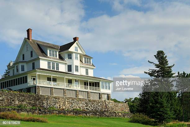 grand mansion on a hill - moosehead lake stock photos and pictures