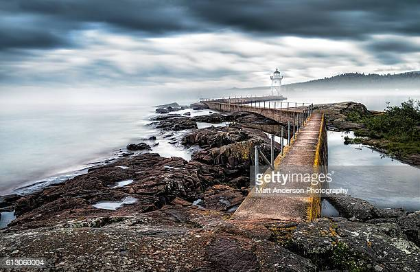 grand marais lighthouse in fog - dramatic landscape stock pictures, royalty-free photos & images