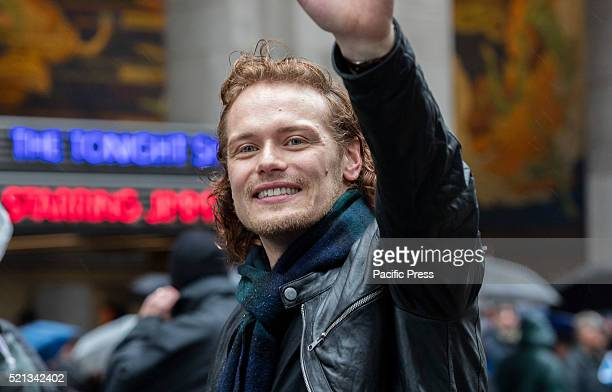Grand Marshal and Outlander Star Sam Heughan march along Sixth Avenue in New York City during the Rainy 2016 Tartan Day Parade The parade is the...