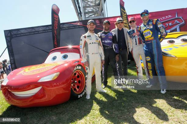 Grand Marshal Owen Wilson voice of Lightning McQueen in 'Cars 3' poses with NASCAR racers Daniel Suarez Bubba Wallace Ryan Blaney and Chase Elliott...