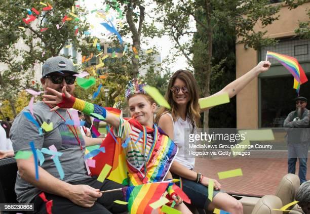 Grand Marshall CJ Duron with his parents Matt and Lori throws confetti as they kick off OC Prideu2019s Blaze Forward Pride Parade in Santa Ana on...