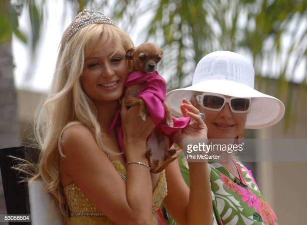 Grand Marshall Paris Hilton and her mother Kathy Hilton ride on the float at the 2005 West Hollywood Gay Pride Parade June 12 2005 in Los Angeles...