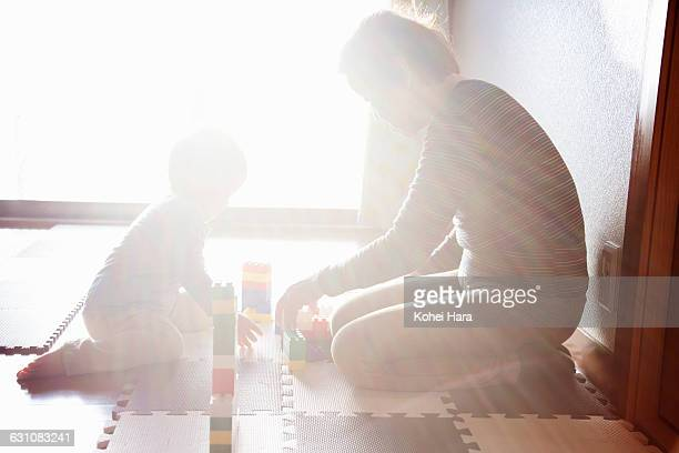 grand mother and boy playing with the blocks