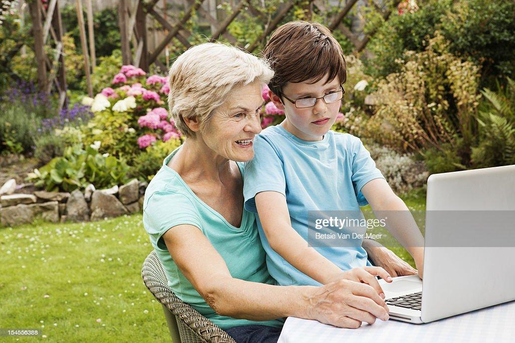 Grand mother and grandchild using laptop. : Foto de stock